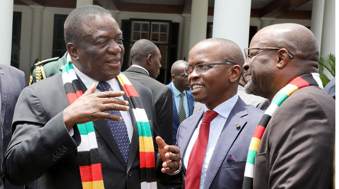 President Mnangagwa speaks to members of the Presidential Advisory Council, businessman Dr Shingi Munyeza (second from right) and prominent lawyer Mr Edwin Manikai, at the inaugural meeting of the council at State House. - Picture by Tawanda Mudimu