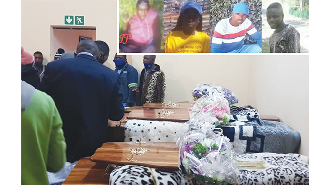 Family and friends pay their last respects to the late four family members in South Africa