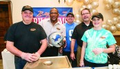C.R. Conant of Auburn Hills, Billy Sims of Dallas, Texas, Tyler Jenkins, Billy Sims BBQ owner David Harris and Hanna Sircy, all of Troy