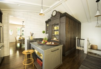 Remodeled powder room and laundry room concealed behind the domed clock cupboard. Center: Remodeled kitchen with island and domed clock cupboard; view into the dining room.