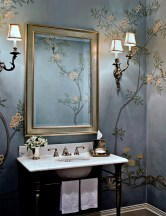 """""""We worked with a local artist who did a mural in a client's powder bath,"""" said Michelle Mio of Rariden Schumacher Mio Interior Design, Birmingham. """"We loved a very expensive silk wallpaper that was not practical for a room used by children on a daily basis. In collaboration with the artist, we worked to change the pattern and color from the original wallpaper concept and came up with a design that was elegant but, more importantly, functional for our client's needs."""" Photo by Jeff Garland"""