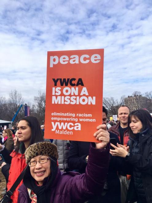 Diana Jeong holds a poster for the Malden YWCA.