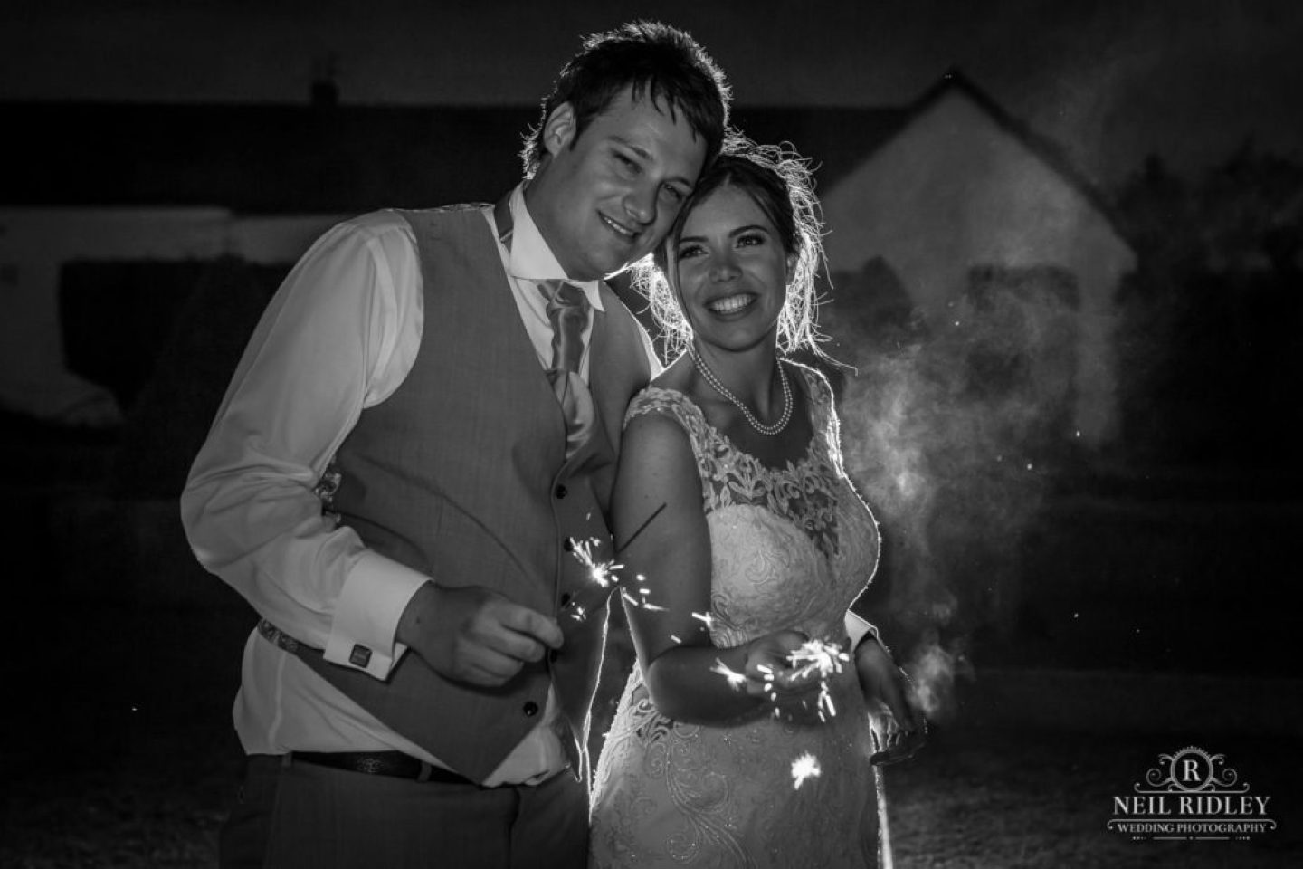 Black and white sparkler image of Bride and Groom at The Great Hall at Mains.