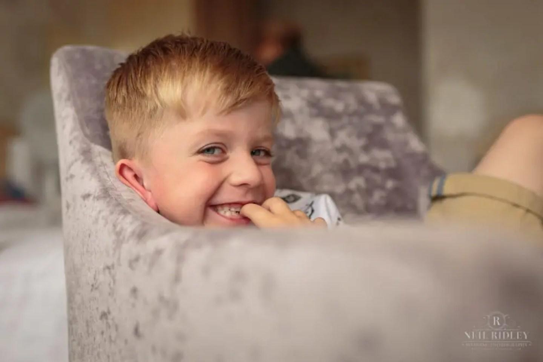 Brides Grandson sat on sofa at The Park House Hotel, Blackpool