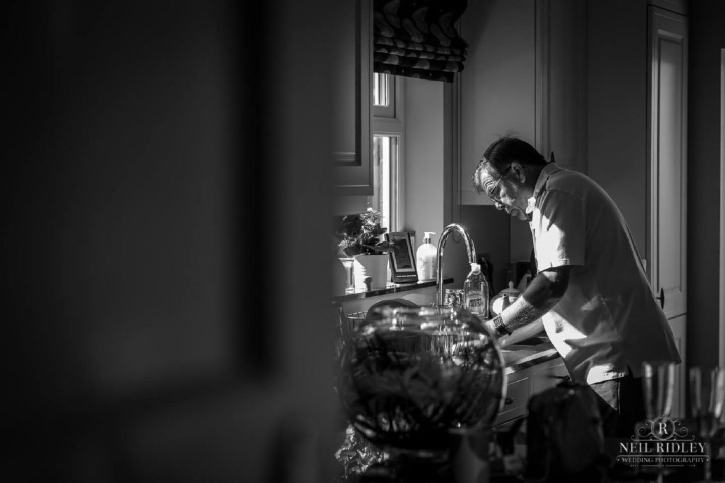 Black and white image of Father washing up during Bridal Prep