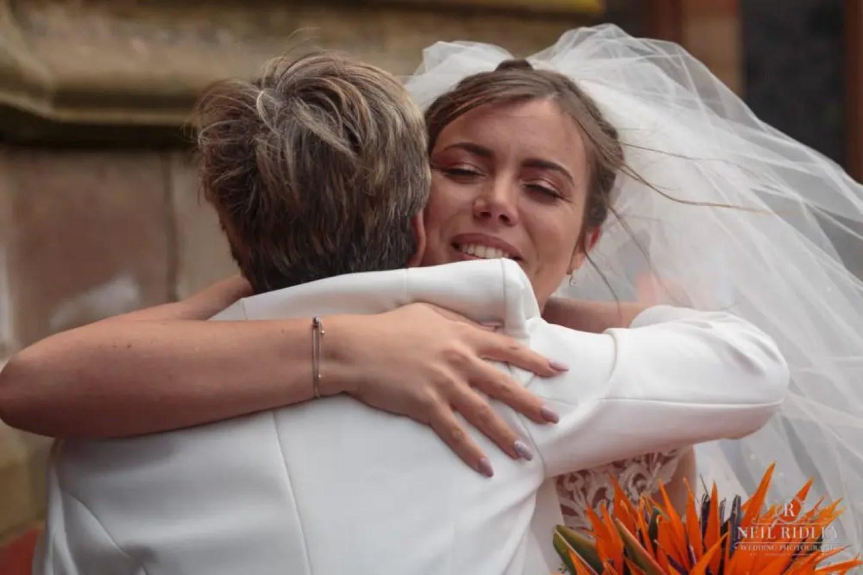 Bride hugs family member outside St Thomas Church in St Annes-on-Sea