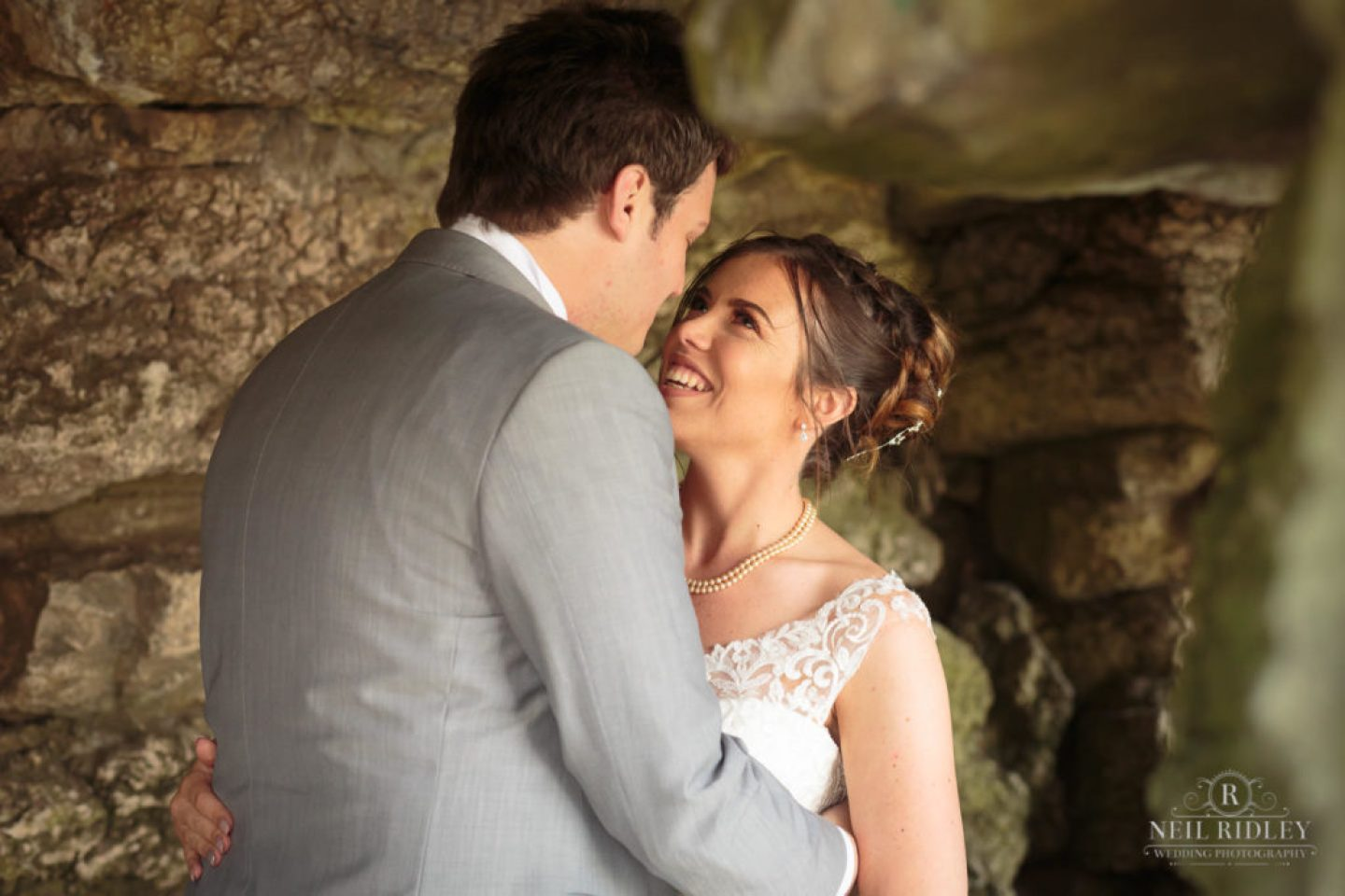 Bride and Groom next to rocks at St Annes Memorial Park