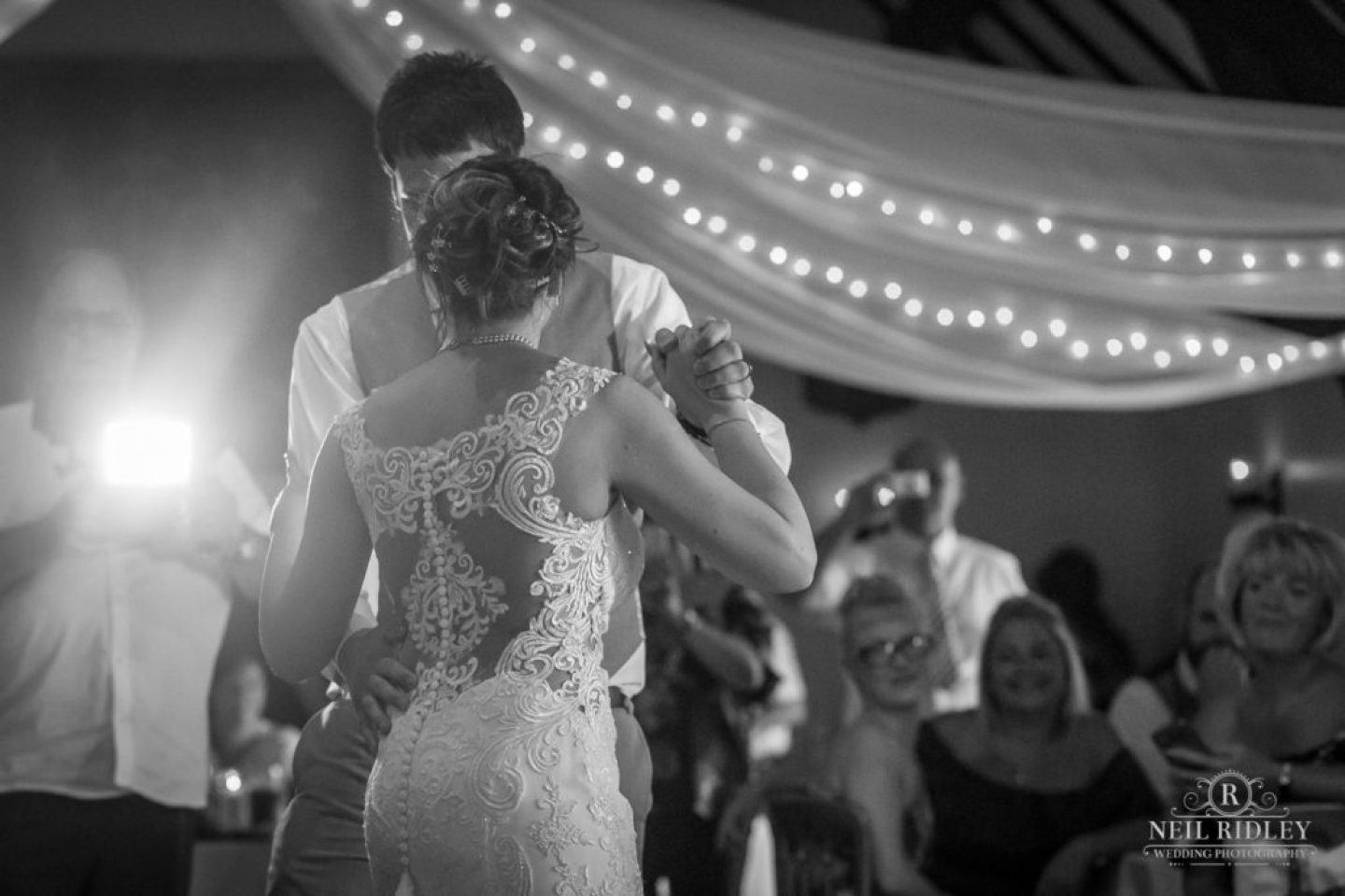 Black and white image of Bride and Groom enjoying the First Dance at The Great Hall at Mains