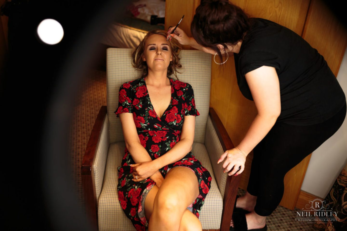 Lancaster Wedding Photographer - Bride sat in a chair during Bridal Prep at Lancaster House Hotel