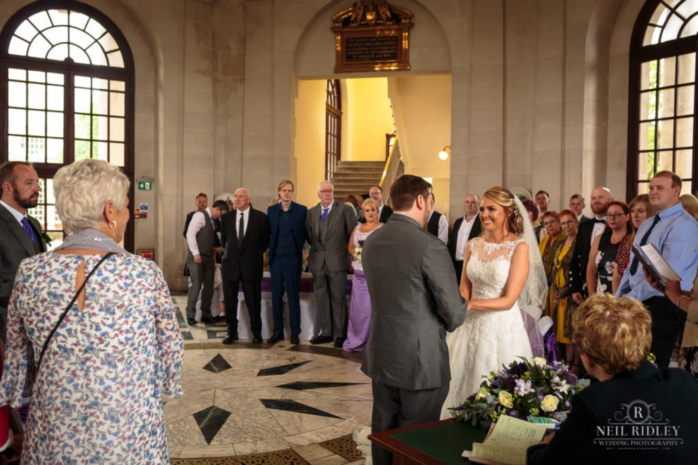 Lancaster Wedding Photographer - Bride and Groom exchange vows at Ashton Memorial Lancaster