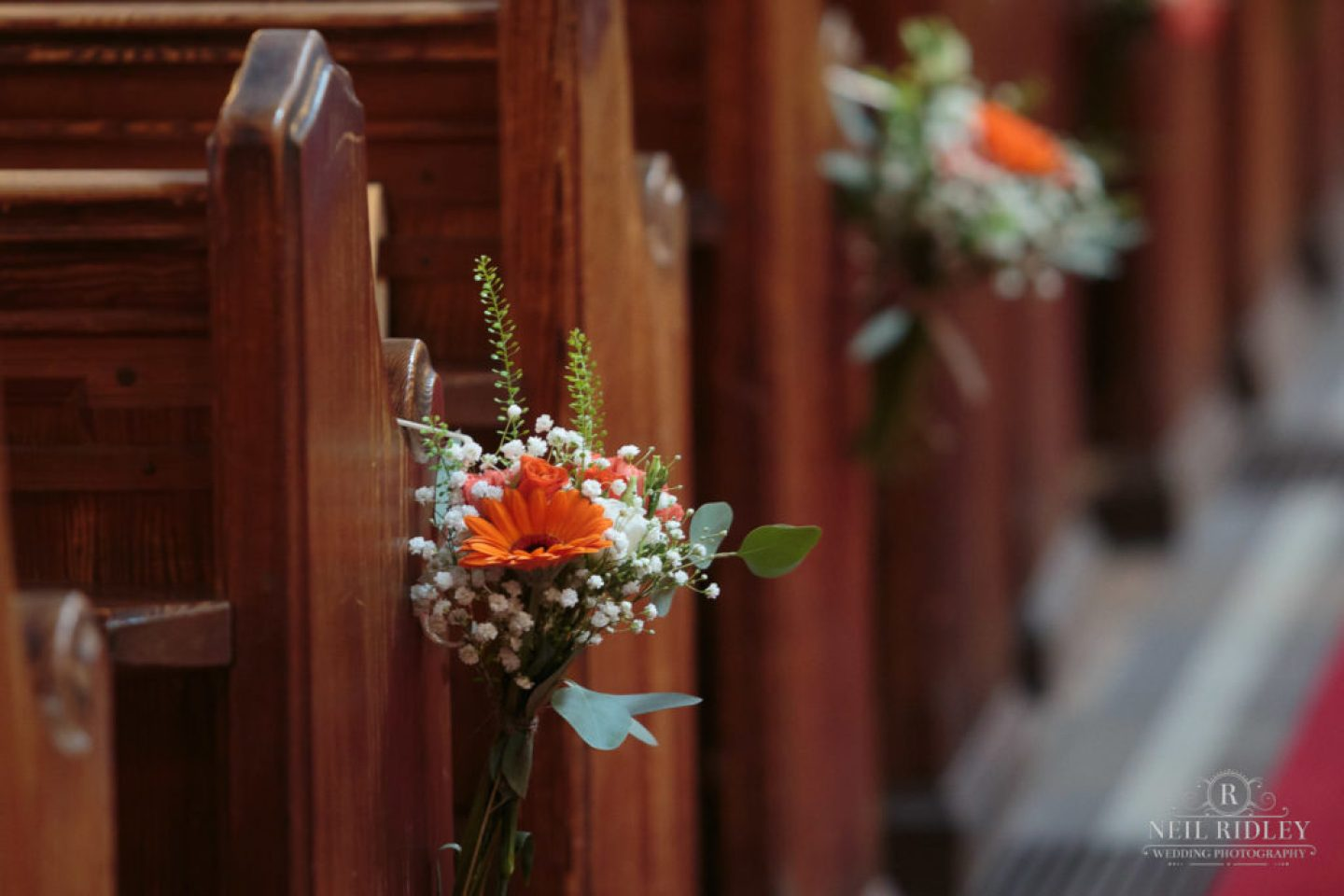 Flowers on church pew at St Thomas Church in St Annes-on-Sea