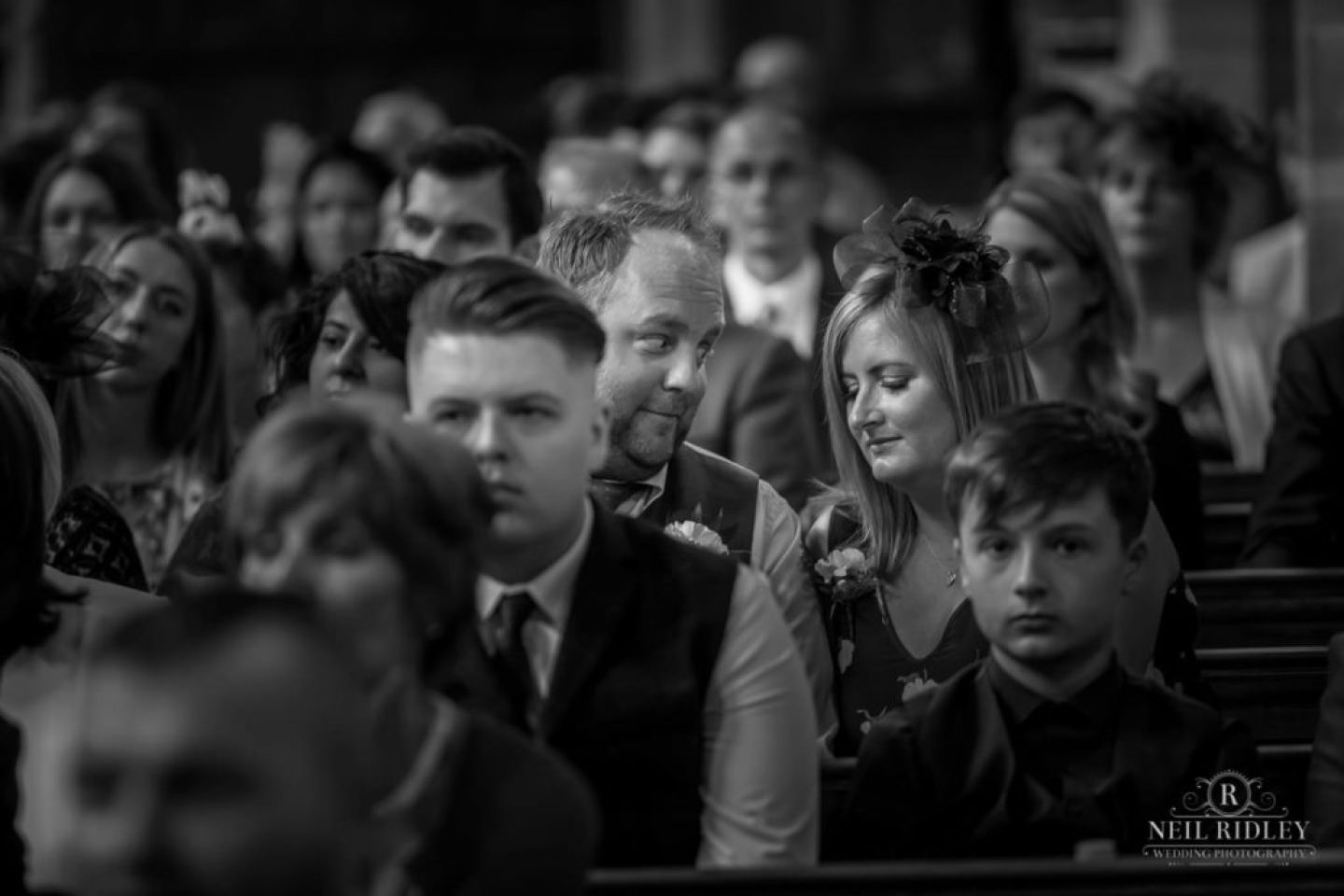 Black and white image of Wedding Guests in St Thomas Church in St Annes-on-Sea