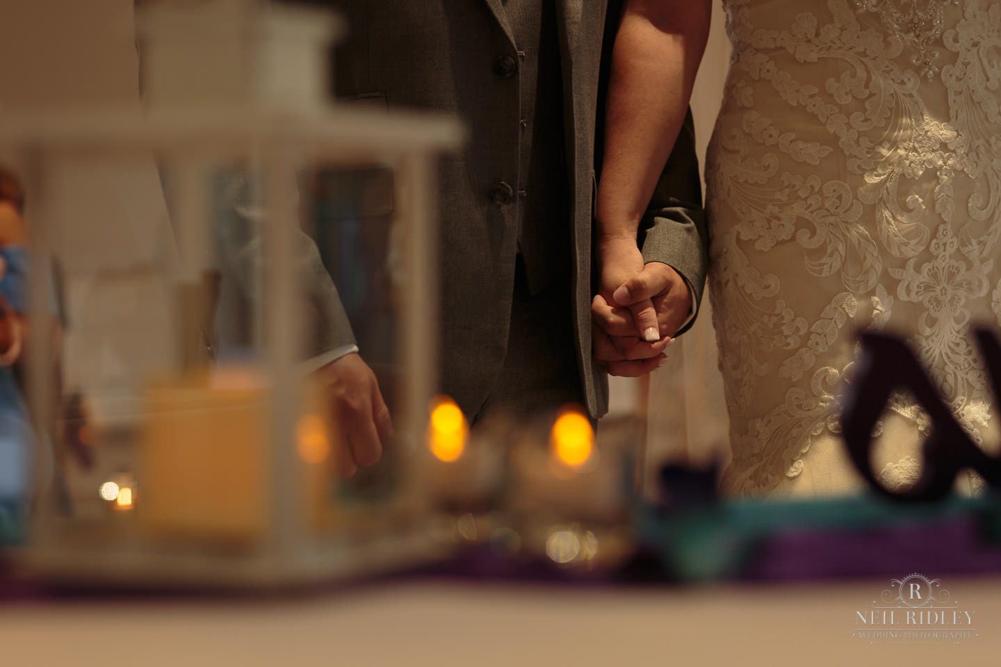 Bride and Groom hgold hands during the Wedding Ceremony at The Mill at Conder Green