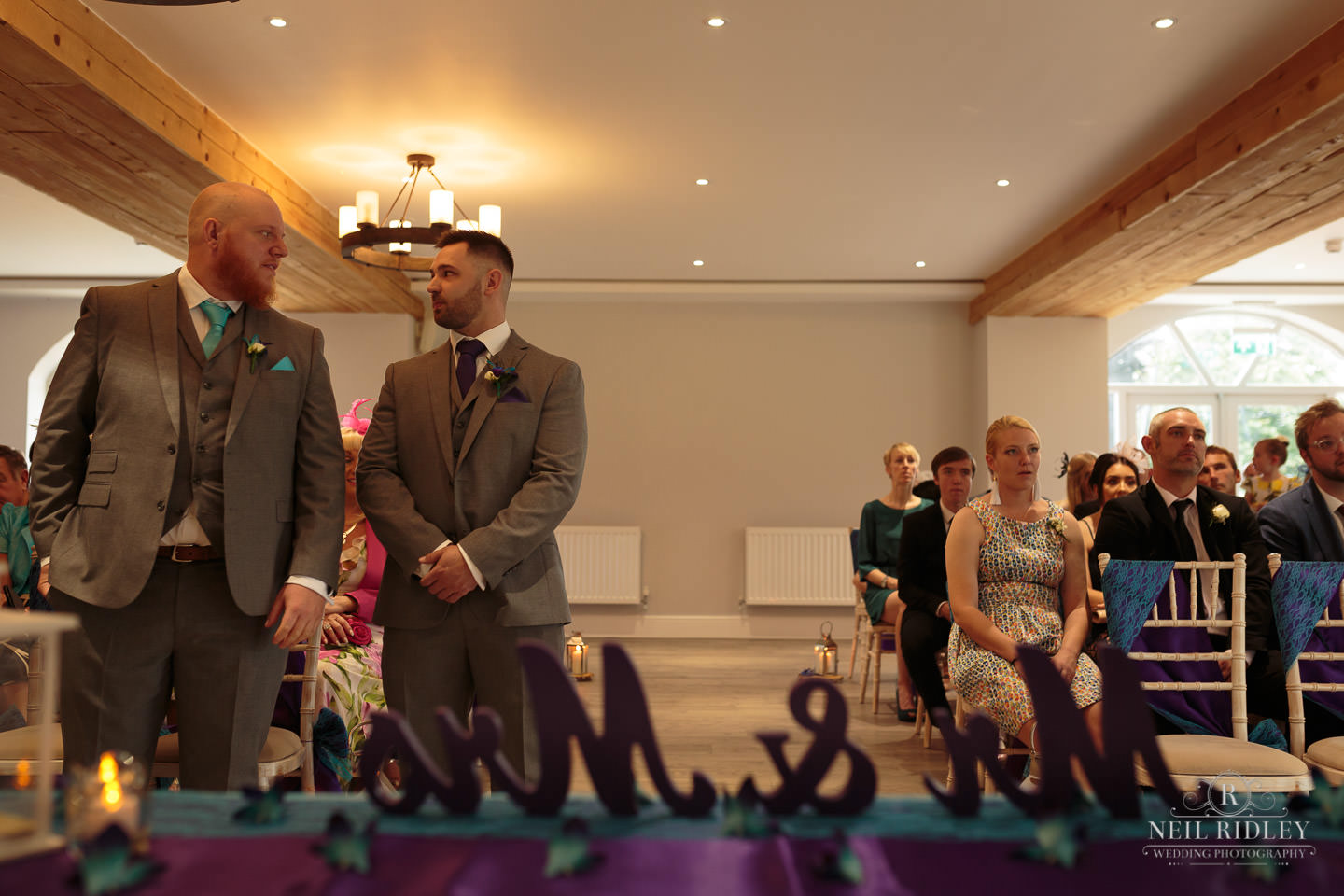 Groom waits patiently for his bride at The Mill at Conder Green