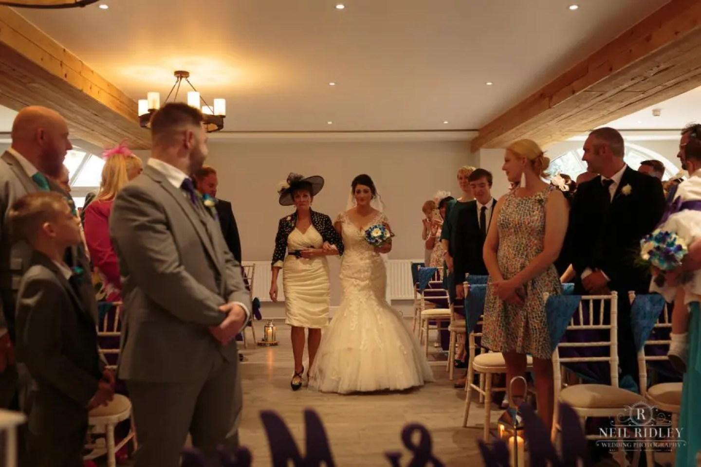 Bride walks down the aisle at The Mill at Conder Green