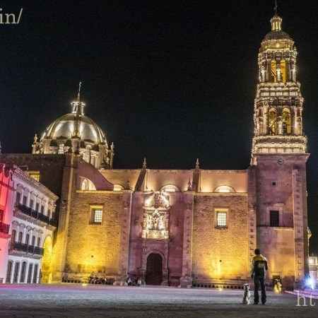 Man his dog admire the Catedral Zacatecas