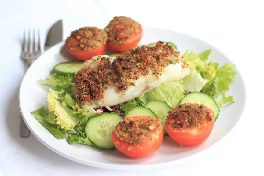 This grilled fish provencal is a super easy quick healthy meal. Tender baked white fish fillets with a golden crunchy breadcrumb topping. Sweet tasty tomatoes and a simple salad to accompany. It's great for when you've limited time because you can serve it up in less than an hour!