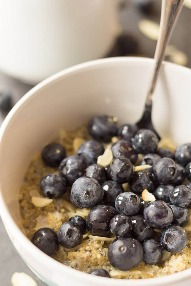 Gluten free and nutty tasting, this vanilla quinoa and blueberry breakfast makes for a delicious healthy alternative to traditional oatmeal. Topped with sweet blueberries, crunchy almonds and just a drizzle of honey, this amazing nutritious breakfast will give you the best possible start to your day!