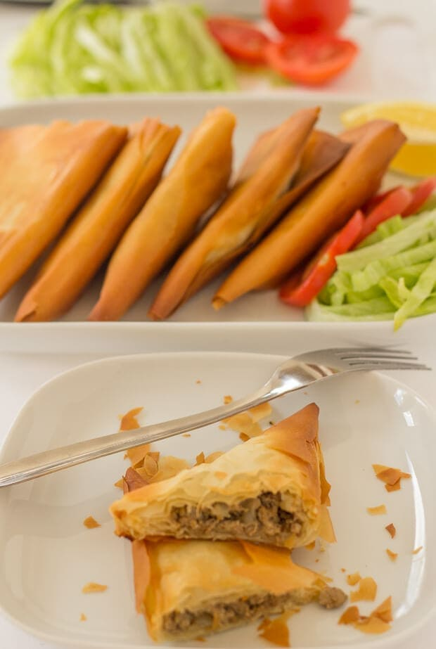 These turkey filo pastry samosas are nearly a third of the calories of those you might find in a restaurant. They're filled with a delicious lightly spiced turkey mince, then baked rather than deep fried, making them a great quick healthy meal!