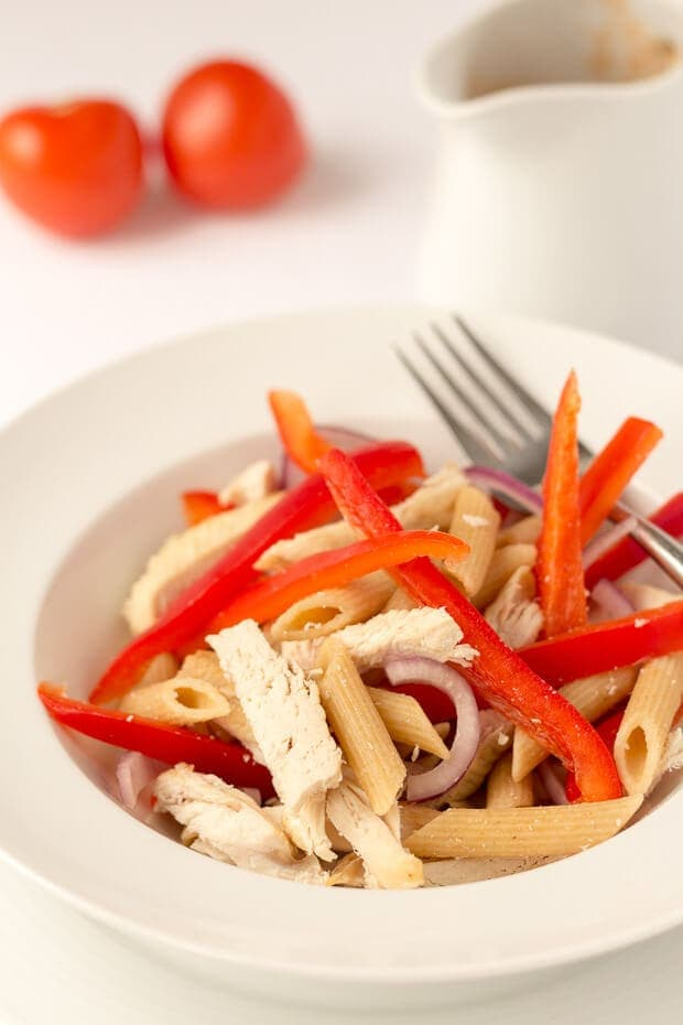 Chicken pasta salad with tomato vinaigrette is just the thing when you're looking for a quick healthy meal. Ideal as either a lunch or a dinner option, you'll find the delicious, tangy tomato vinaigrette perfectly versatile and an ideal way to liven up your other pasta salad recipes too!