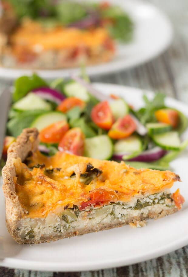 This cheesy tomato and kale quiche recipe makes 8 tasty slices. It's ideal for lunch boxes and also a quick and easy dinner, perfect served with a salad..