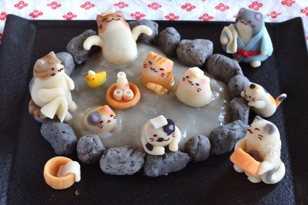 180225catspa 600x400 - 露天のお風呂に集う猫たち、肩まで浸かっていい湯だな
