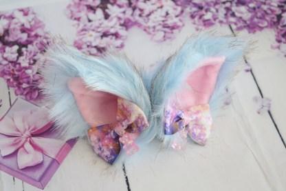 Blue kitten play ears