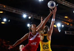 Netball players jumping for the ball