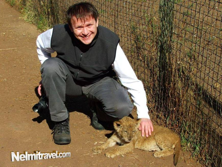 Andrey touching a small lion cub. He loved it!