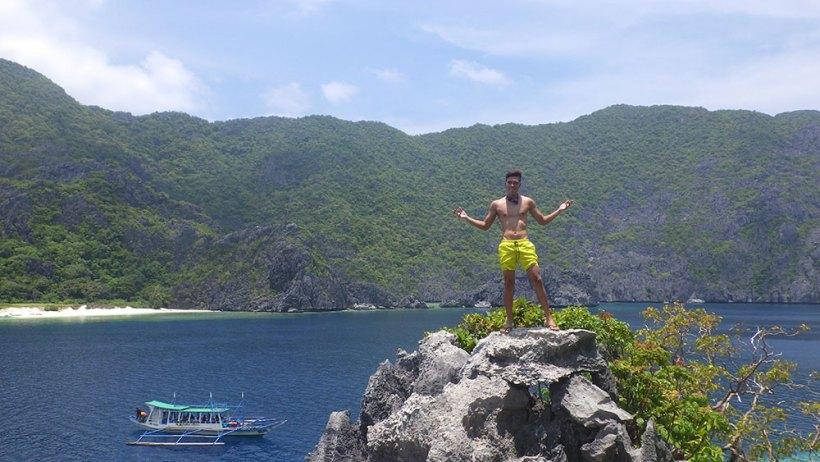 Climbing cliffs in Matinloc Island