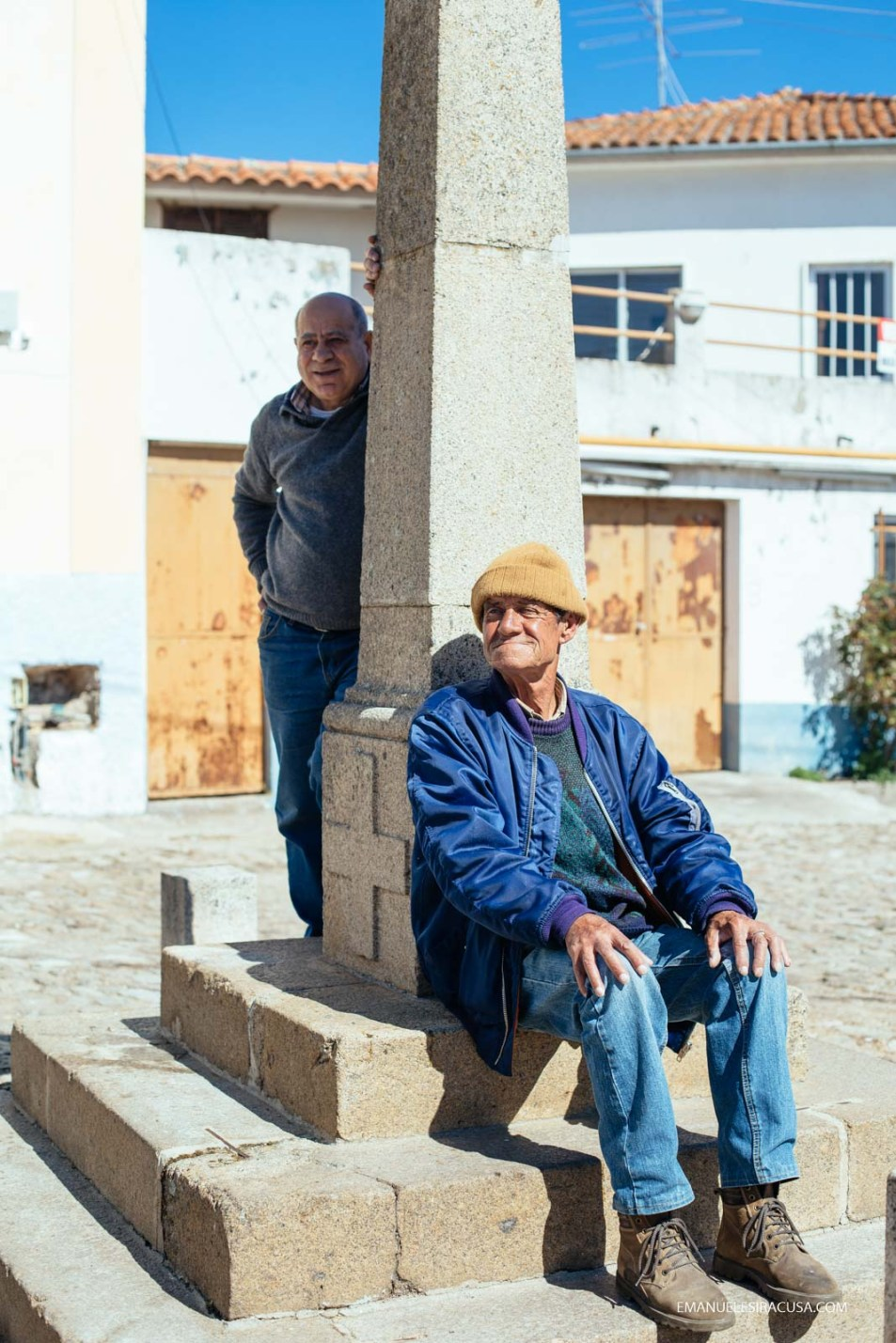 Two elderly man sit at the centre of the main square in the village of Proença a Velha, 2016