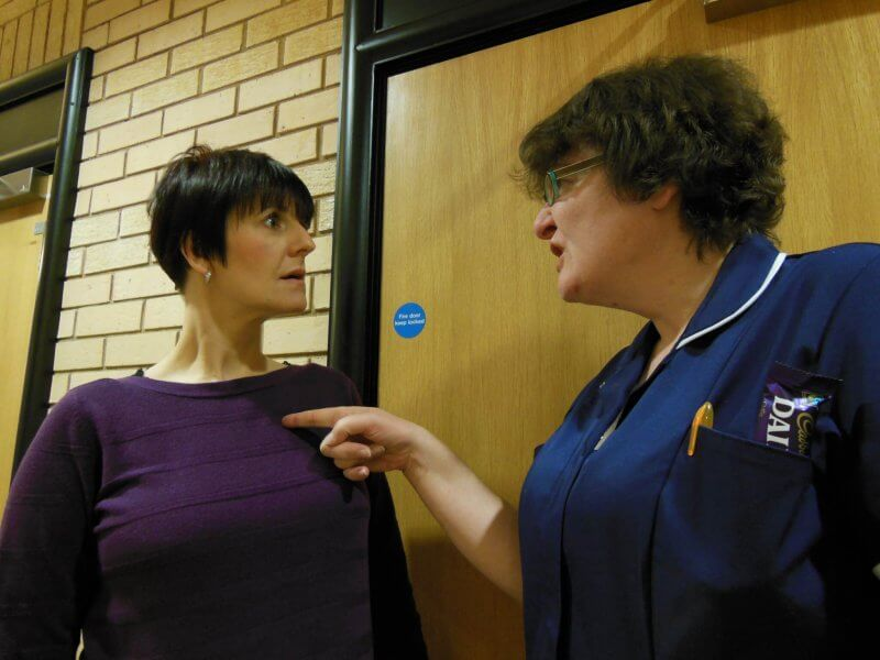 Image showing a nurse manager bullying a member of staff