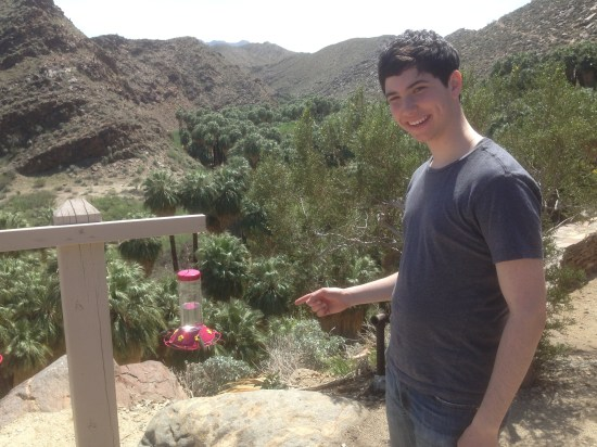 Yours truly with two Costa's Hummingbirds (Photo by Geoff Goldberg)