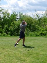 Bedford Police Chief Bobby Bongiorno takes a swing.