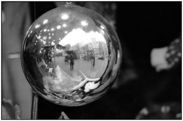 Reflection in a Christmas ball, by Ferdinando Scianna