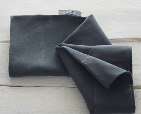 The dark blue skin to skin kangaroo wrap is recommended by childcare untis for full term or premature babies