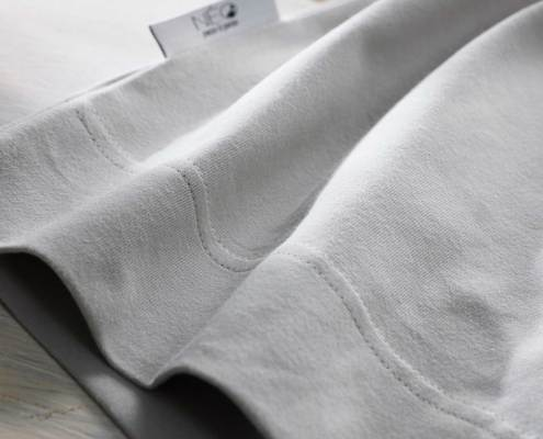 NEO linen grey kangaroo and skin to skin wrap detail recommended by childcare units for full term or premature babies