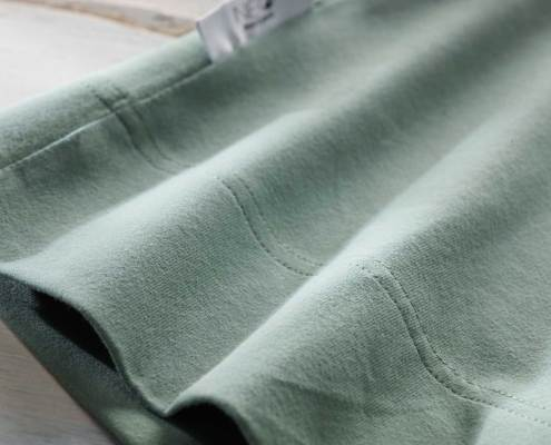 NEO almond green kangaroo and skin to skin wrap detail recommended by childcare units for full term or premature babies