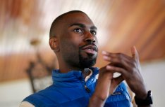 In this March 26, 2016 photo, Baltimore mayoral candidate DeRay Mckesson chats with campaign volunteers before canvassing in Baltimore. Mckesson is known on the national stage for his role in Black Lives Matter, but he's struggling as he campaigns for mayor in his hometown. (AP Photo/Patrick Semansky)