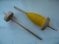 A soon to be growing spindle collection along with a full cop of merino singles in need of plying.