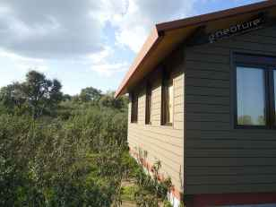Revestimiento fachadas en madera tecnologica mod. NeoLack