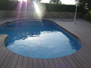 Tarima exterior piscina forma circular