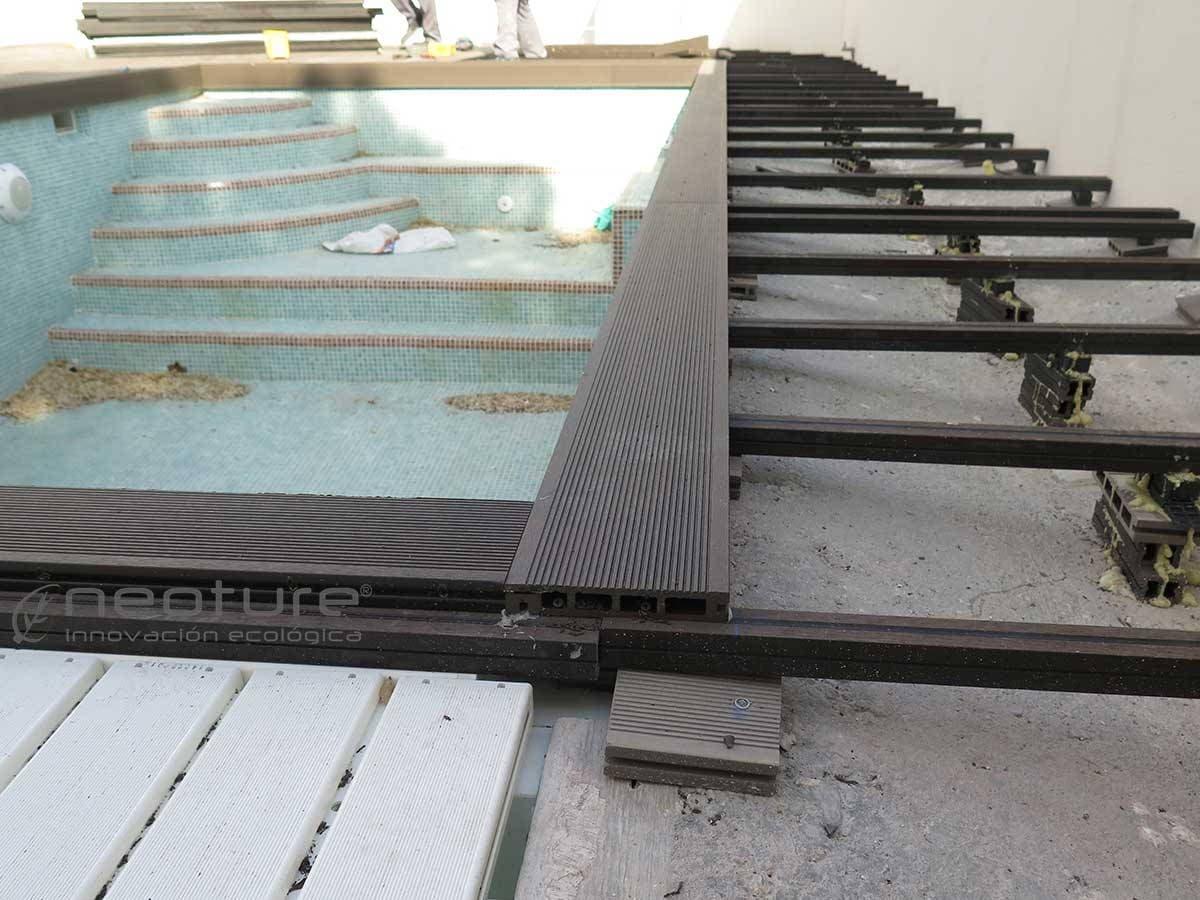 montaje de mamperlanes en tarima madera sintetica exterior piscina