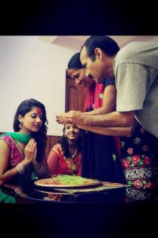 Keki Adhikari Receiving Dashain 2013 from her father Tika Image 2