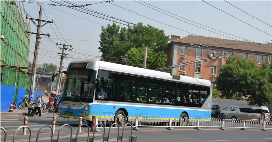 Electric buses run on Beijing street