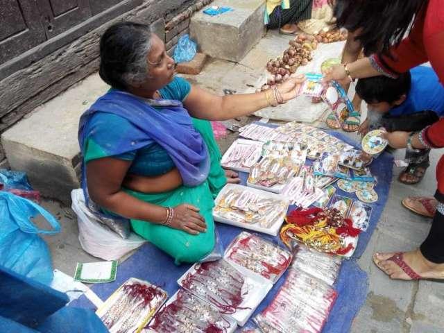 Women selling rakhi in streets of Kathmandu for Raksha Bandhan.