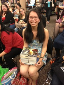 Lisa Hoang of The Consummate Reader blog with books for signing.