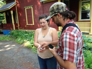 Researcher Thom Bullock shows homeowner how to hold and release a Carolina wren as part of the Neighborhood Nestwatch (Nancy Eve Cohen)