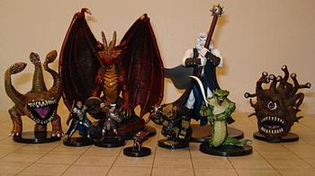 Several Dungeons and Dragons miniature figures. ...
