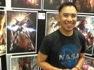 John T Chiang with his Defender of the Universe! His original artwork is super cool!